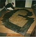Nailing a large fur coat, Germany 1987.jpg