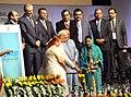"Narendra Modi lighting the lamp at the ""Invest Madhya Pradesh - Global Investors Summit 2014"", at Indore, Madhya Pradesh on October 09, 2014. The Speaker, Lok Sabha, Smt. Sumitra Mahajan and other dignitaries are also seen.jpg"