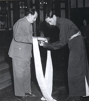 Ngapoi Ngawang Jigme - Ngapoi (right) offers a khata to Mao Zedong (left) as a delegate to the Beijing peace negotiations, 1951