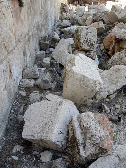 Excavated stones from the Western Wall of the Temple Mount (Jerusalem, Israel), knocked onto the street below by Roman battering rams in 70 AD NinthAvStonesWesternWall.JPG