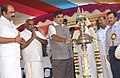 Nitin Gadkari lighting the lamp at the foundation stone laying ceremony of ten road development projects for Tamil Nadu, at Suchindrum, Kanyakumari. The Minister of State for Road Transport & Highways and Shipping.jpg