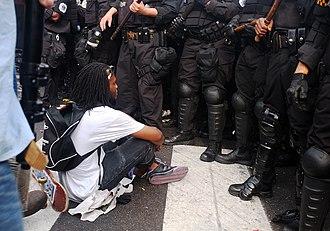 """Nonviolent resistance - A """"No NATO"""" protester in Chicago, 2012"""