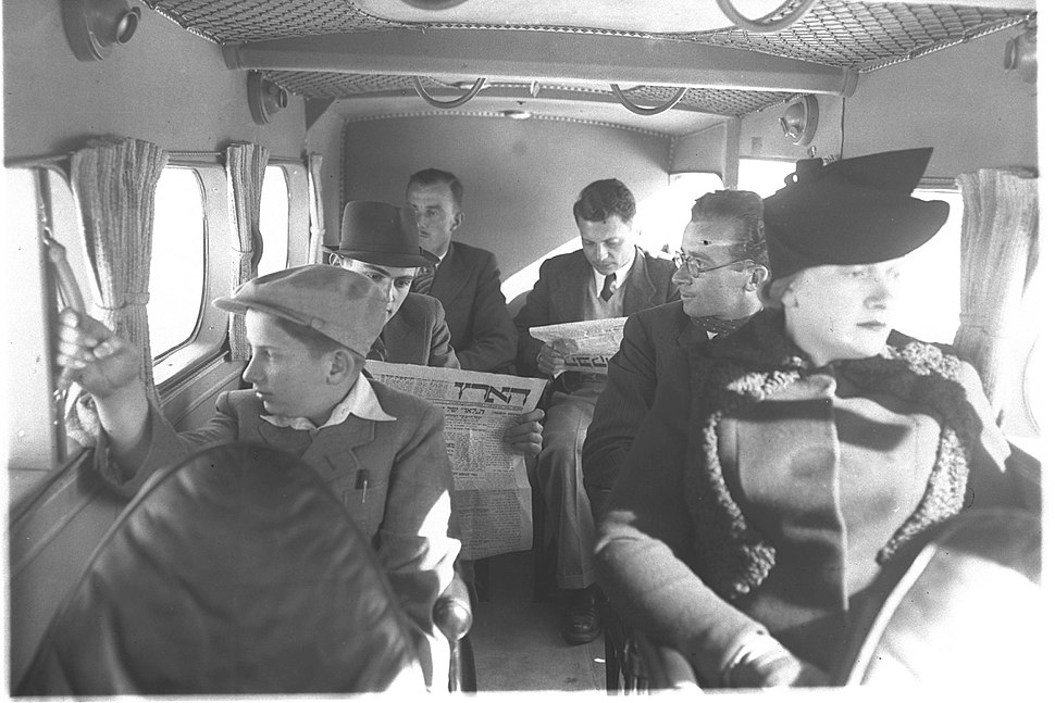 PASSENGERS SEATED IN ONE OF THE PALESTINE AIRWAYS %22SCION%22 PLANES DURING FLIGHT. %D7%A0%D7%95%D7%A1%D7%A2%D7%99%D7%9D %D7%91%D7%9E%D7%94%D7%9C%D7%9A %D7%98%D7%99%D7%A1%D7%94 %D7%A9%D7%9C %D7%97%D7%91%D7%A8%D7%AA %22%D7%A0%D7%AA%D7%99%D7%91%D7%99 %D7%90%D7%95%D7%99%D7%A8 %D7%90%D7%A8%D7%A5 %D7%99%D7%A9%D7%A8%D7%90%D7%9C%22.D2-055