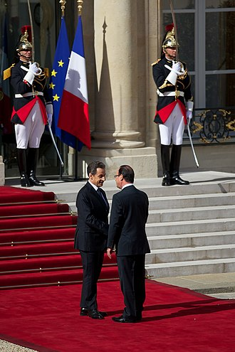 François Hollande - Hollande (right) and outgoing President Nicolas Sarkozy at Élysée Palace on inauguration day, 15 May 2012