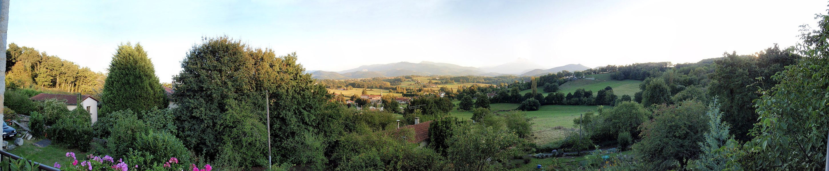 Panorama of en:Ganties, in the en:Haute-Garonne, in France. Panorama is a composite of 17 photos, taken from a balcony, overlooking the village. The Pyrenees mountains are in the background. View is looking south towards the mountains (and Spain behind them).