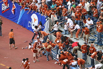 Accident - A railing accident at a Texas Longhorns college football game, spilling fans onto the sidelines