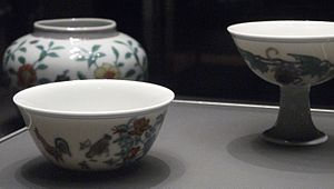 """Doucai - Chenghua pieces, 1464–87; in the foreground a """"chicken cup"""" like that sold in 2014 at Sotheby's."""