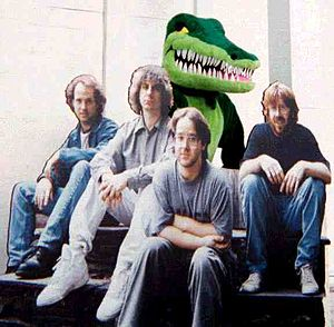 Phish festivals - Concert's alligator mascot and a cutout of the band which was featured in the concert's entertainment village