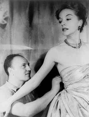 Haute couture - Pierre Balmain adjusting a dress on model Ruth Ford in 1947 (photographed by Carl Van Vechten)