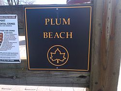 """Plum Beach"" sign in Plumb Beach"
