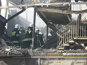 Kamień Pomorski homeless hostel fire - Polish firefighters searching for victims.