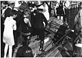 Policeman pulling trunk with murder victim's body out of Lake Union, Seattle, August 8, 1921 (MOHAI 2218).jpg