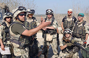 Polish involvement in the 2003 invasion of Iraq - A Polish Army soldier patrol leader debriefs his team after completing an afternoon patrol around the perimeter of Camp Babylon, Iraq.