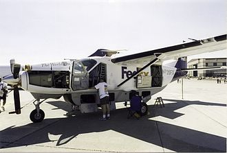 Cessna 208 Caravan - A Fedex Super Cargomaster with cargo pod. The Cargomaster and Super Cargomaster variants are built without cabin windows.