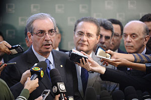 Michel Temer - Eduardo Cunha (left) at a press conference with fellow PMDB member Renan Calheiros (middle) on 21 May 2015.