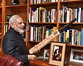 Prime Minister Narendra Modi holds a cricket bat at the Nelson Mandela Foundation, South Africa.jpg