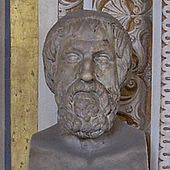 Bust of a somewhat elderly and rather tired-looking man with a short, curly beard, vaguely similar to Greek busts of Homer