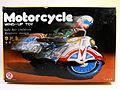 QSH Tin Wind Up Motorcycle Box Art.jpg