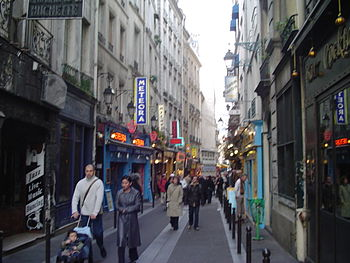 A small street in the Latin Quarter with bistr...