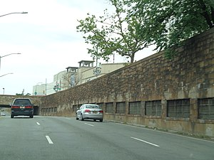IND Queens Boulevard Line - As part of the subway line's construction, underpasses were built at Kew Gardens (top) and Woodhaven Boulevard (bottom).