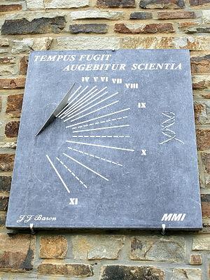 Tempus fugit - An example of the phrase as a sundial motto in Redu, Belgium.