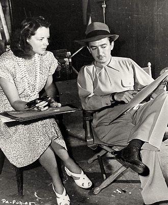 John H. Auer - Costume designer Renié and John H. Auer on the set of Pan-Americana (1945)