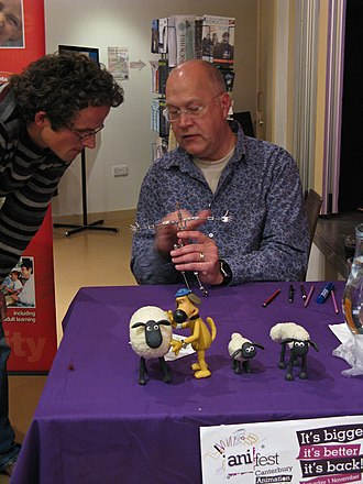 Shaun the Sheep - Series director Richard Goleszowski at Canterbury's Anifest 2008 with models of a generic sheep, Bitzer, Timmy, and Shaun