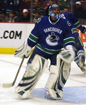 Roberto Luongo during the 2008-09 season, with a C visible on his goalie mask denoting his captaincy. He was named captain of the Canucks in September 2008. Roberto Luongo 03-2009.jpg