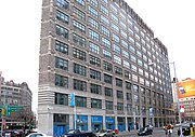 """Building facade with interior window treatments reading """"The Jackie Robinson Museum"""""""
