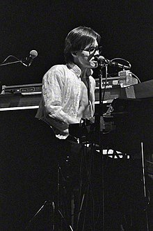 Powell performing at a concert in Arcosanti with Utopia, 1978