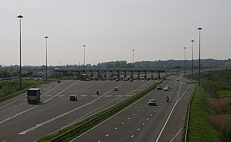 M4 motorway - The westbound carriageway tolls (left), near Rogiet, and the three-lane eastbound carriageway (right).