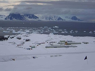 Rothera Research Station - Rothera Station from Reptile Ridge (above the station) in November 2003. The preceding winter had been one of very heavy snow accumulation.