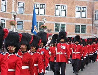 Full dress uniform - The Royal 22nd Regiment during the 400th anniversary parade of Quebec City. Most regiments in the Canadian Army utilizes scarlet tunics as a part of their full dress uniform.