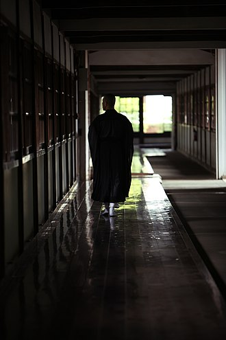 Sōji-ji - Monk in the corridor which is polished like glass twice a day