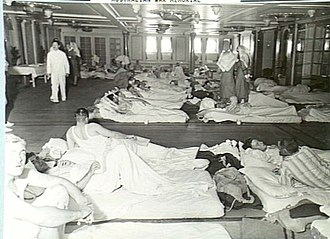 RMS Empress of Canada (1920) - SS Empress of Canadas ballroom was cleared for sleeping as ANZAC troops are transported from the Antipodes to the war zones in the Northern Hemisphere. This specific image was captured at sea in January 1940 near Fremantle, Western Australia.