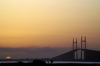Suez - Sunset view from land to Suez Canal Bridge, which links Africa with Asia