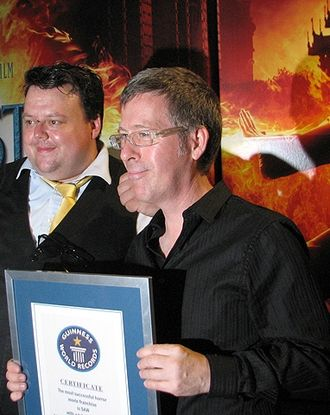 "Saw (franchise) - The Saw series was placed in the Guinness World Records as the ""Most Successful Horror Franchise"". Pictured here is director Kevin Greutert receiving the award at the 2010 Comic-Con."