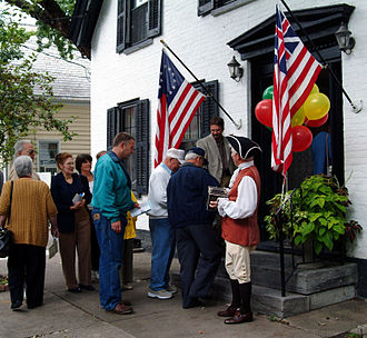 Schenectady, New York - An accordion-playing guide welcomes visitors to a restored Dutch home in the Schenectady Stockade District