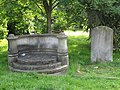 Seat by the grave - geograph.org.uk - 1380884.jpg