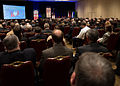 Secretary of the Navy Ray Mabus, background, delivers remarks during the 25th annual Surface Navy Association National Symposium at the Hyatt Regency Crystal City in Arlington, Va 130117-N-AC887-002.jpg