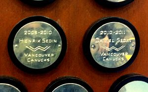 Daniel Sedin - Daniel's plaque (right) on the Art Ross Trophy, beside Henrik's (left).