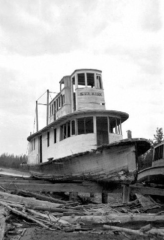 Steamboats of the upper Columbia and Kootenay Rivers - Abandoned steamboats at Golden, BC ca 1926. Selkirk is clearly shown, a portion of a smaller unidentified vessel is visible on right.