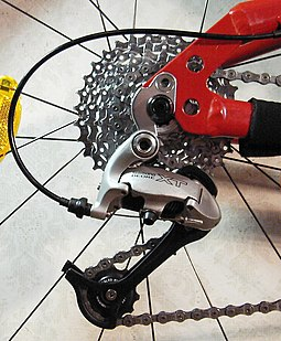 A set of rear sprockets (also known as a cassette) and a derailleur Shimano xt rear derailleur.jpg