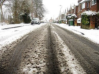 Slush - Melted snow in a roadway that has turned to slush in the wheel paths