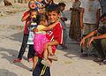 Small Iraqis with big smiles greet MND-B CG as he patrols area DVIDS111845.jpg