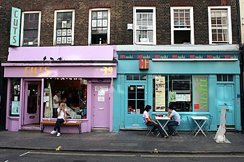 English: Colorfully painted shop windows in a ...