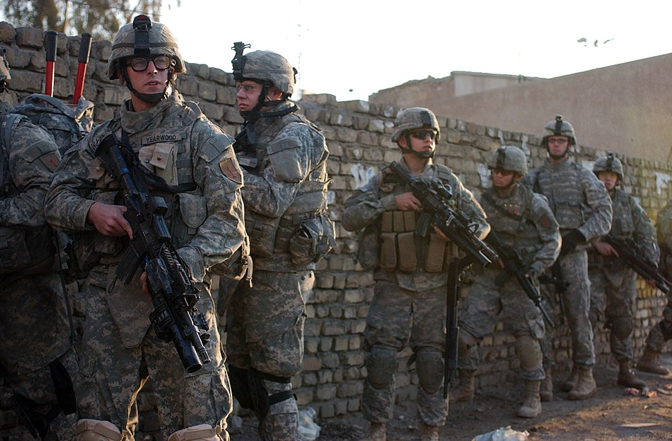 Soldiers from C Company, 1st Battalion, 26th Infantry Regiment, 2nd Brigade Combat Team, 1st Infantry Division, perform a Cordon and Search operation in Al Adhamiya, Baghdad, Iraq, Feb. 21, 2007