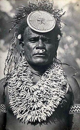 Culture of Solomon Islands - Solomon Islands chief wearing a spectacular porpoise tooth chest ornament and kap-kap.  Portrait of Irobaoa of Suafa, north Malaita, circa 1910.