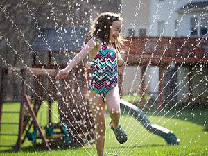 Irrigation sprinkler - An oscillating sprinkler is commonly used to water residential lawns, and is moved as needed.