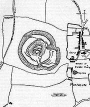 Drawing showing two concentric almost circular rings near the centre. The church and other buildings of the village are to the right.